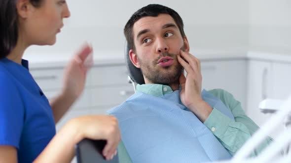 hombre-visita-dentista